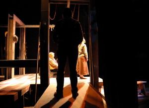 Joe Debevc in silhouette in the world premiere of Eric Samuelsen's MIASMA (2006)
